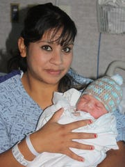 Aida Reyes, with her son, Carlos Soltero Jr. the first baby born in 2015 at Sierra View District Hospital in Porterville.