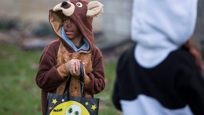 Trick-or-treaters from across the community go door to door collecting candy on Oct. 31 for Halloween. Hundreds of kids in costume from across the area took part to fill their bags full of candy in 2017.