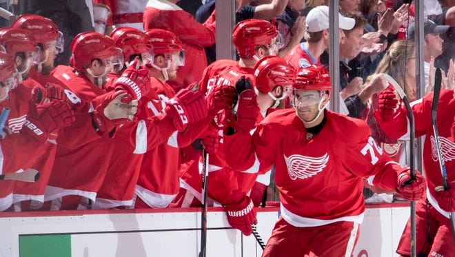 Detroit center Andreas Athanasiou gets high-fives from his teammates after scoring in the second period.