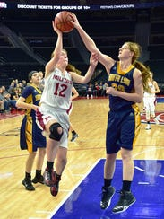 Milford's Sydney Stankovich (left) gets her shot blocked