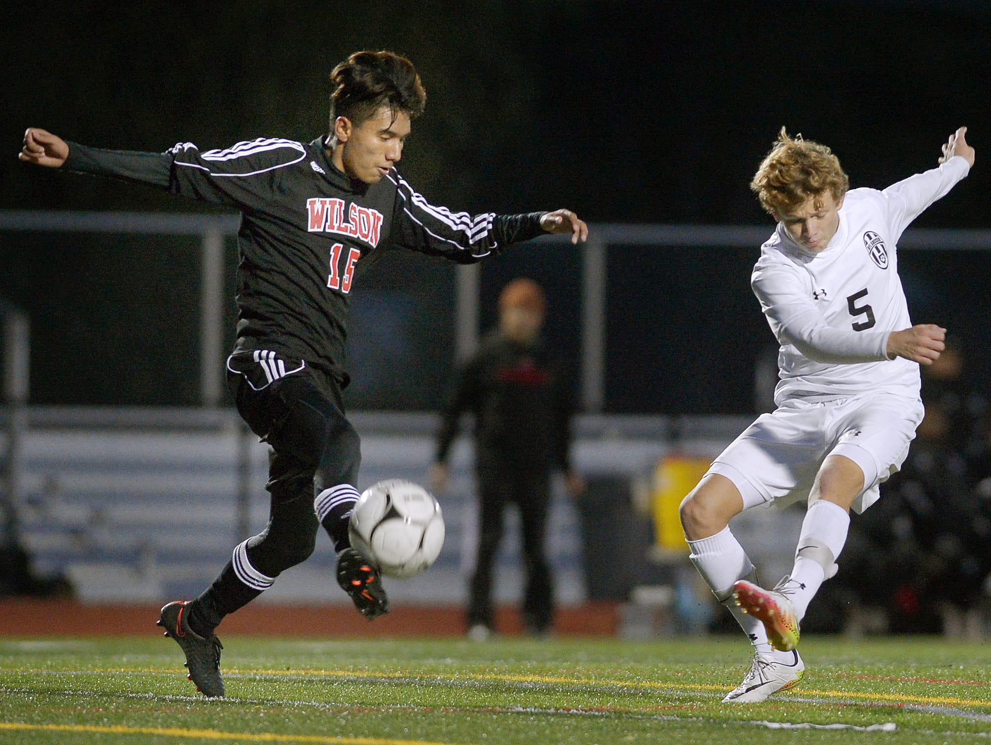 Wilson's Amrit Gurung, left, blocks a kick by HF-L's Roth Wetzel during the Section V Class A2 final at Hilton High School on Oct. 28, 2016.
