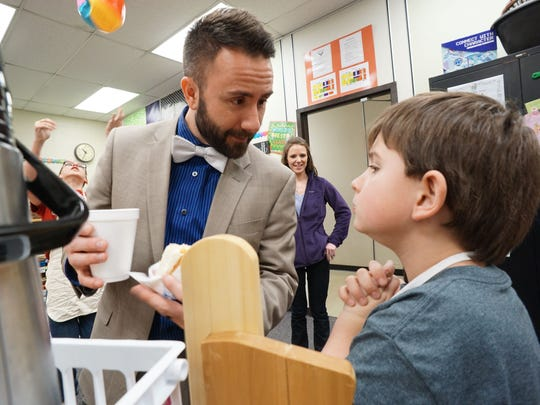 Buddy Miller, shown here getting coffee and a donut from a student in 2016, resigned from his post as Eastern Elementary School principal effective Jan. 31 for personal reasons.