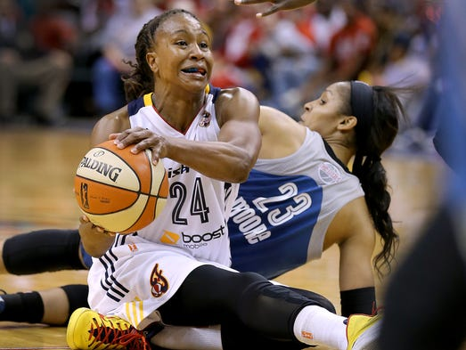 Indiana Fever forward Tamika Catchings (24) steals