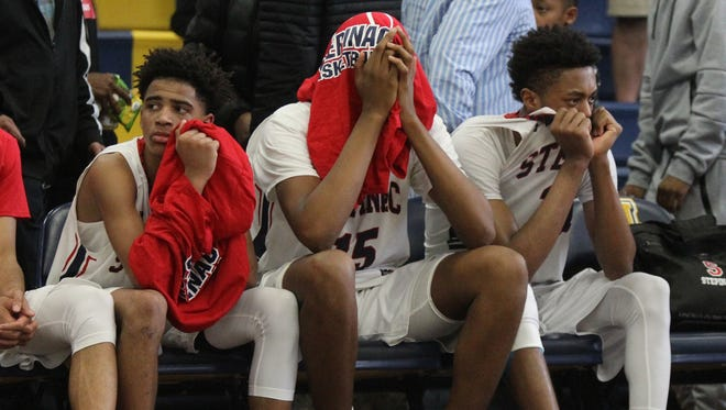 "Stepinac's RJ Davis, left, Joel Soriano and Alan Griffin sit on the bench after their 73-69 loss to Mt. Saint Michael in the CHSAA 'AA"" section final basketball game at Mount St. Michael High School on Saturday, February 25, 2017."