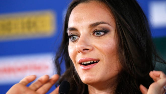 Russia's Yelena Isinbayeva, the gold medalist in the women's pole vault,  speaks during a press conference at the World Athletics Championships in the Luzhniki stadium in Moscow, Thursday.