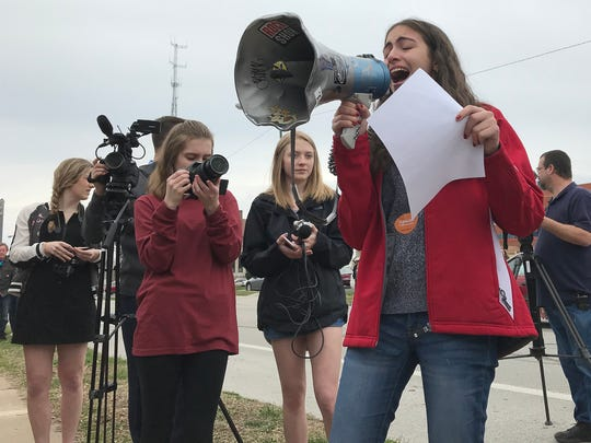 Central High School student Carla Hamwi grew tearful as she spoke to the crowd gathered outside the school on Friday, March 23, 2018. Hamwi and about 250 other Central students walked out in protest of gun violence along with 150 students from Drury University for a joint protest.