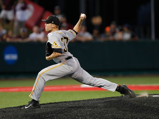 Iowa's Nick Gallagher (30) pitches in the first inning against Texas A&M during an NCAA college baseball tournament regional game Saturday, June 3, 2017, in Houston. (Tim Warner/Houston Chronicle via AP)