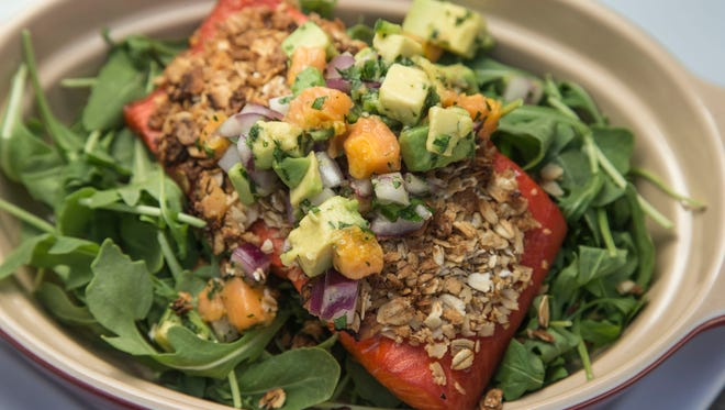 Celebrated Cuisine, Inc. owner Laura Briscoe makes LocoCoconut Crusted Salmon with Avocado Papaya Salsa on Tuesday, August 5, 2014.