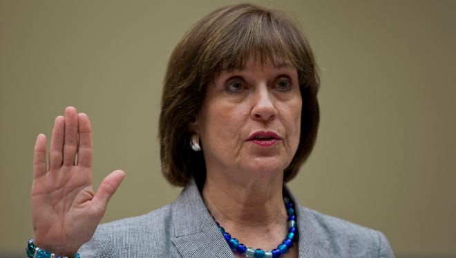 IRS official Lois Lerner is sworn in during an Oversight Committee hearing May 22, 2013.