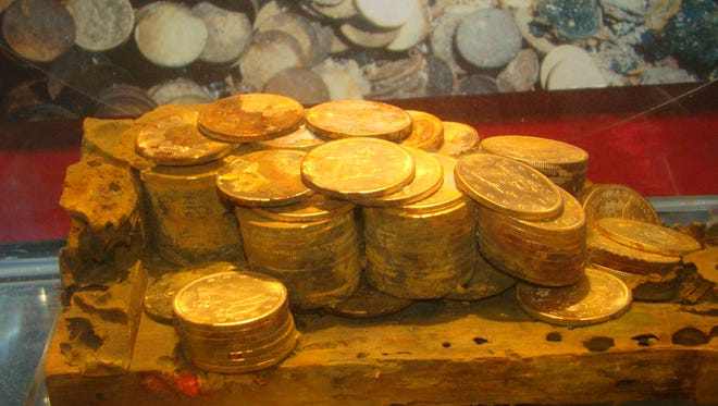 In this February 2010 photo provided by Donn Pearlman, the gold remains of a wooden cargo box unearthed from the SS Central America is shown at a coin collection expo in Long Beach, Calif.