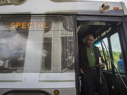 Attorney John Due steps off a Star Metro bus after taking a symbolic ride in honor of the 60th anniversary of the Tallahassee bus boycott on May 26.