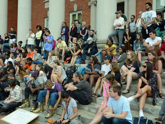 A large crowd covered the steps of Sikes Hall as student organizers announced they were suspending their sit in Thursday.
