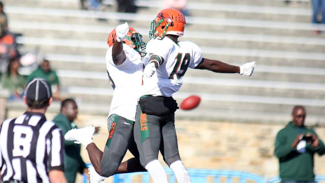 Ricky Henrilus and Kareem Smith celebrate Henrilus' game-winning touchdown over the Morgan State Bears.