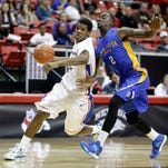 Boise State's Derrick Marks drives past San Jose State's D.J. Brown during the first half of their Mountain West Tournament quarterfinal game Wednesday in Las Vegas.