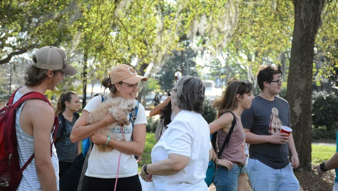 It was all smiles at the Puppy Take Over, hosted by Coping Through College, on the Union Green.