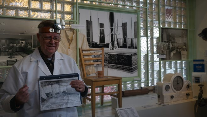 Dr. Howard W. Baumann, a retired gastroenterologist in Salem, reenacts Dr. William L. Lidbeck's involvement in the tragic poisoning that left 47 patients dead at Oregon State Hospital. He uses an exhibit room at the Museum of Mental Health as a backdrop.