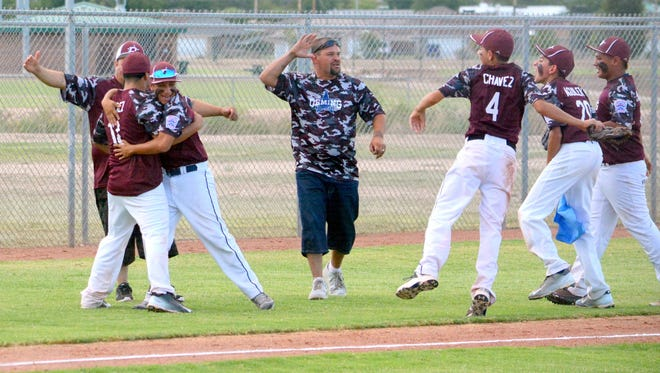 Deming celebrates winning the junior league sectional title Saturday at Carlsbad.