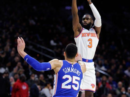 New York Knicks' Tim Hardaway Jr. (3) takes a jump shot over Philadelphia 76ers' Ben Simmons (25) in the first half of an NBA basketball game, Monday, Feb 12, 2018, in Philadelphia. (AP Photo/Michael Perez)