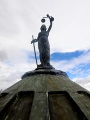 Lady Justice stands atop the Cascade County Courthouse.