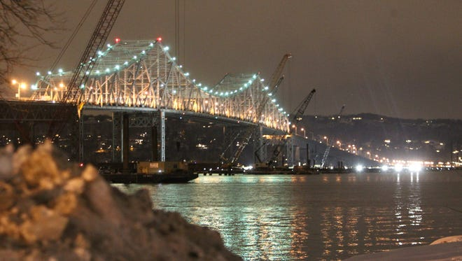 The Tappan Zee Bridge and some construction barges carrying cranes and other equipment are illuminated at night, as seen from Losee Park in Tarrytown in late January.