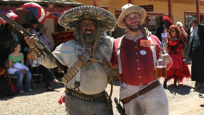 Creighton & Kelly Washington from Tulsa, OK, enjoy the festivities during the annual Wyatt Earp Days in Tombstone.