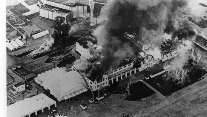 The Commercial and Natural Resources buildings at the Oregon State Fairgrounds are destroyed by fire on July 31, 1967. The fire was caused by arson. Seen in the background is the Salem Armory Auditorium. The Women's World building is to the left of the burning buildings.