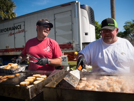 Tiki Bar & Grill owner John Campbell (left) and volunteer