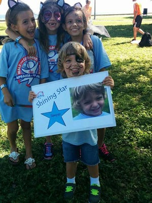 Sawyer Falcon and his friends at the 2015 Walk for Children with Apraxia in Tampa. This year, the walk is coming to Southwest Florida on Nov. 5 at Estero  Community Park.