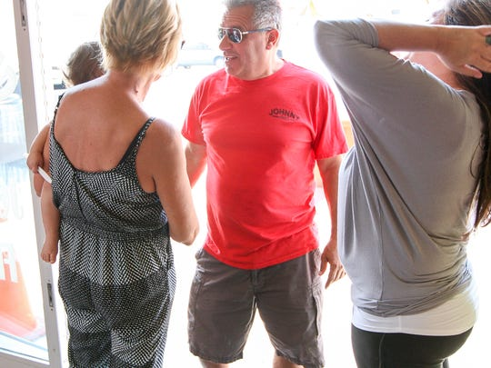 John Spadavecchia, owner of Johnny Fries in Ortley Beach talks with friends on August 26, 2017. Spadavecchia was expecting a solid summer this year. But he wasn't counting on the rain. Instead, business is off about 20 percent. (Photo by Keith Muccilli, Correspondent)