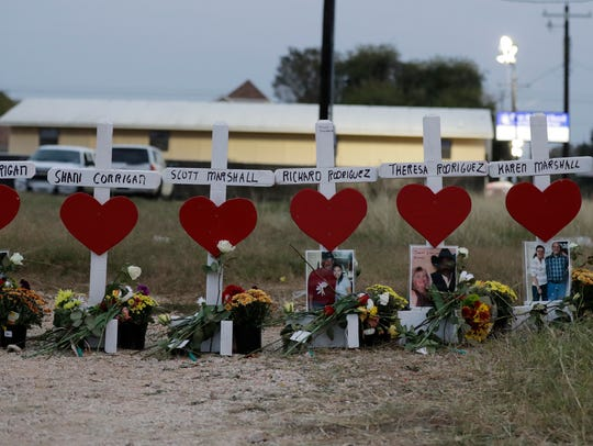 Crosses showing the names of shooting victims at the