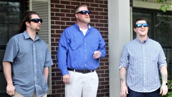 From left, Tim Masters, Mark Yeager and Ian Wilson see the outside world in color for the first time thanks to specially-designed glasses.
