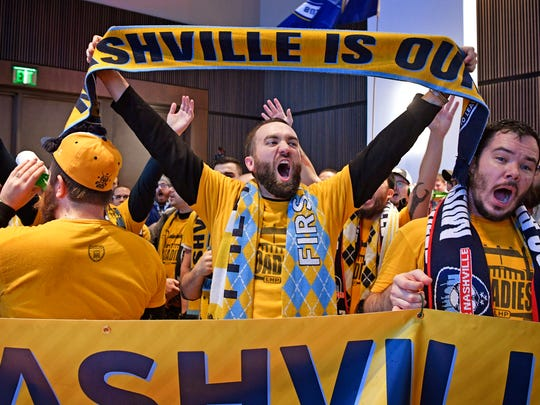 Kyle Mountsier shows his pride for Nashville as members of The Roadies, a Nashville SC supporter group, chant and scream as Major League Soccer officials dubbed Nashville as an expansion city Dec. 20, 2017.
