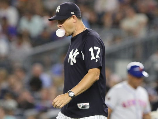Yankee manager Aaron Boone comes to the mound to take out starting pitcher Domingo German in the fourth inning against the Mets at Yankee Stadium on Friday, July 20, 2018.
