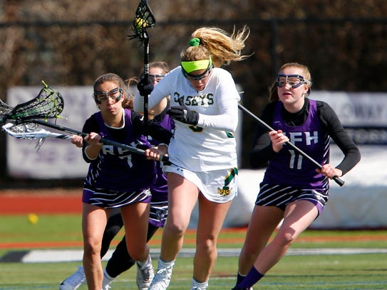 Red Bank Catholic's Abi George (#9) is sandwiched between
