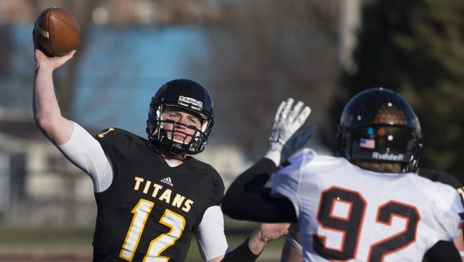 Brett Kasper (12) of UW-Oshkosh launches a pass over Ohio Northern's Jason Hundley (92) in Saturday's NCAA second round playoff game on J.J. Keller Field at Titan Stadium on November 28, 2015.