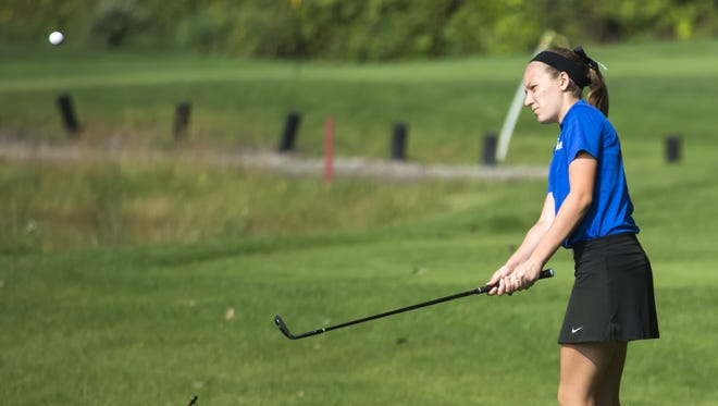 Reagan Beyer of Oshkosh West chips a shot onto the green playing FVA meet at Lake Breeze Golf Course on Thursday.