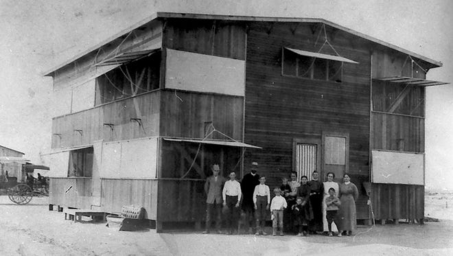 """Ora Weed and his family stand in front of their home in """"Weedville"""" in the summer of 1912."""