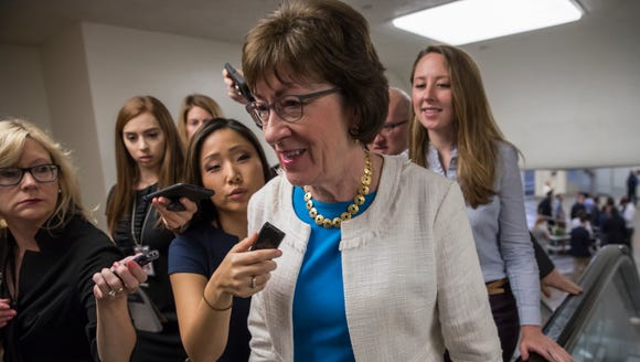 Sen. Susan Collins, R-Maine is surrounded by reporters