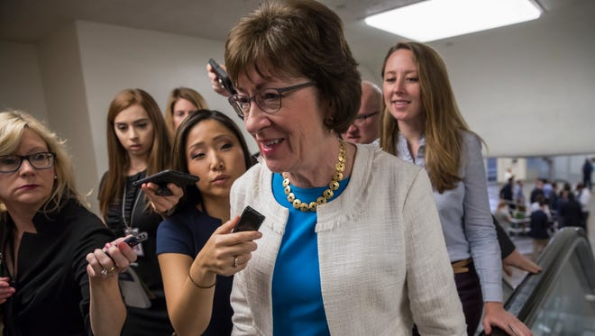Sen. Susan Collins, R-Maine is surrounded by reporters as she heads to the Senate in Washington, Thursday. She was one of three Republican senators whose opposition helped kill a bill to repeal the Affordable Care Act early Friday morning.
