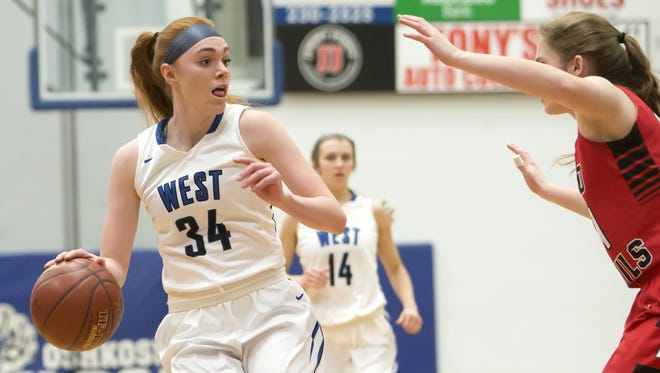 Oshkosh West's Anelise Hammonds looks for a path around Green Bay East Wednesday during the holiday tournament at Oshkosh West High School December 27, 2017.