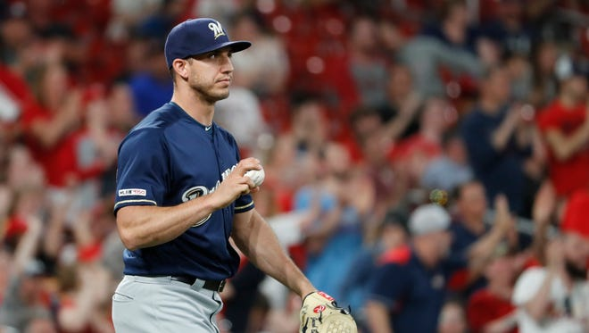 Milwaukee Brewers relief pitcher Jacob Barnes walks back to the mound after giving up an RBI-single to St. Louis Cardinals' Yadier Molina during the seventh inning of a baseball game Monday, April 22, 2019, in St. Louis. (AP Photo/Jeff Roberson) ORG XMIT: MOJR118