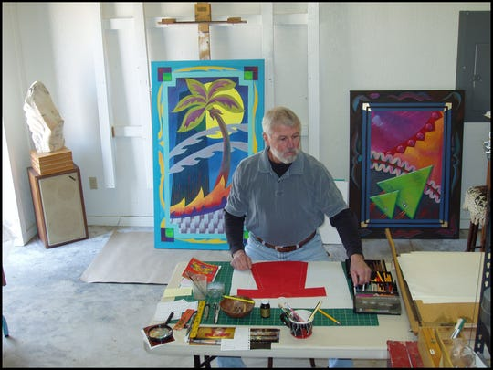 Mixed media artist John Sundstrom works in his studio.