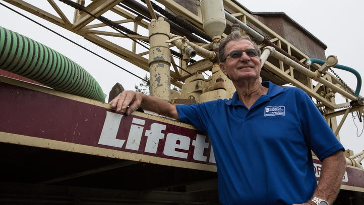 Kenny Wood, President of Lifetime Well Drilling, poses for a photo next to a mud rotary rig, used for drilling water wells, at his business in Denton, Md. on Friday, June 3, 2016.  For the past decade Wood has used his expertise and equipment to help the people of Ghana and Tanzania find clean water.