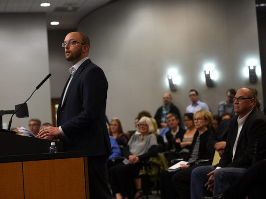 Colin Robertson, left, Director of Communications and Strategy for the Don J Clark Group, speaks during the official presentation of the West 2nd District development project to the Reno City Council on Wednesday. Developer Don Clark is seen on the lower right.
