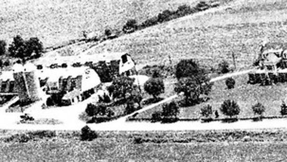 Avalong Farm, with its double barn, operated at the corner of Mount Zion and Whiteford roads. The former Meadowbrook farmhouse and eatery, now operated by Christmas Tree Hill, stands outside the frame to the right.
