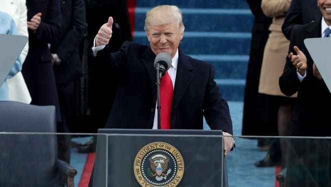 President Donald Trump gives a thumbs up to the crowd, after his inaugural speech on Friday, Jan. 20, 2017.