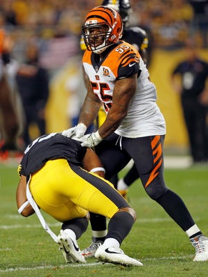 Cincinnati Bengals outside linebacker Vontaze Burfict (55) shoves Pittsburgh Steelers tight end Xavier Grimble (85) to the ground as he attempts to get up after catching a pass during the second half of an NFL football game in Pittsburgh, Sunday, Oct. 22, 2017. The Steelers won 29-14.