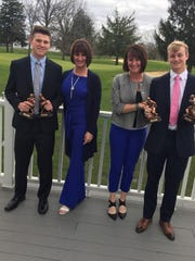 Branson Combs, left, and Michael Lindauer, far right, pose with their mothers, Annette Combs and Jeanette Lindauer, at after an awards ceremony in 2017.