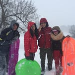 Snow offers headaches for some, fun for others