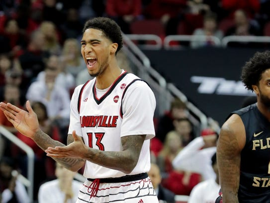 Louisville's Ray Spalding celebrates after scoring